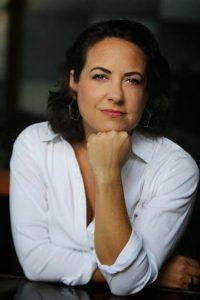 Headshot of Laura Wides Munoz