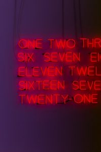 Neon sign listing numbers not in order